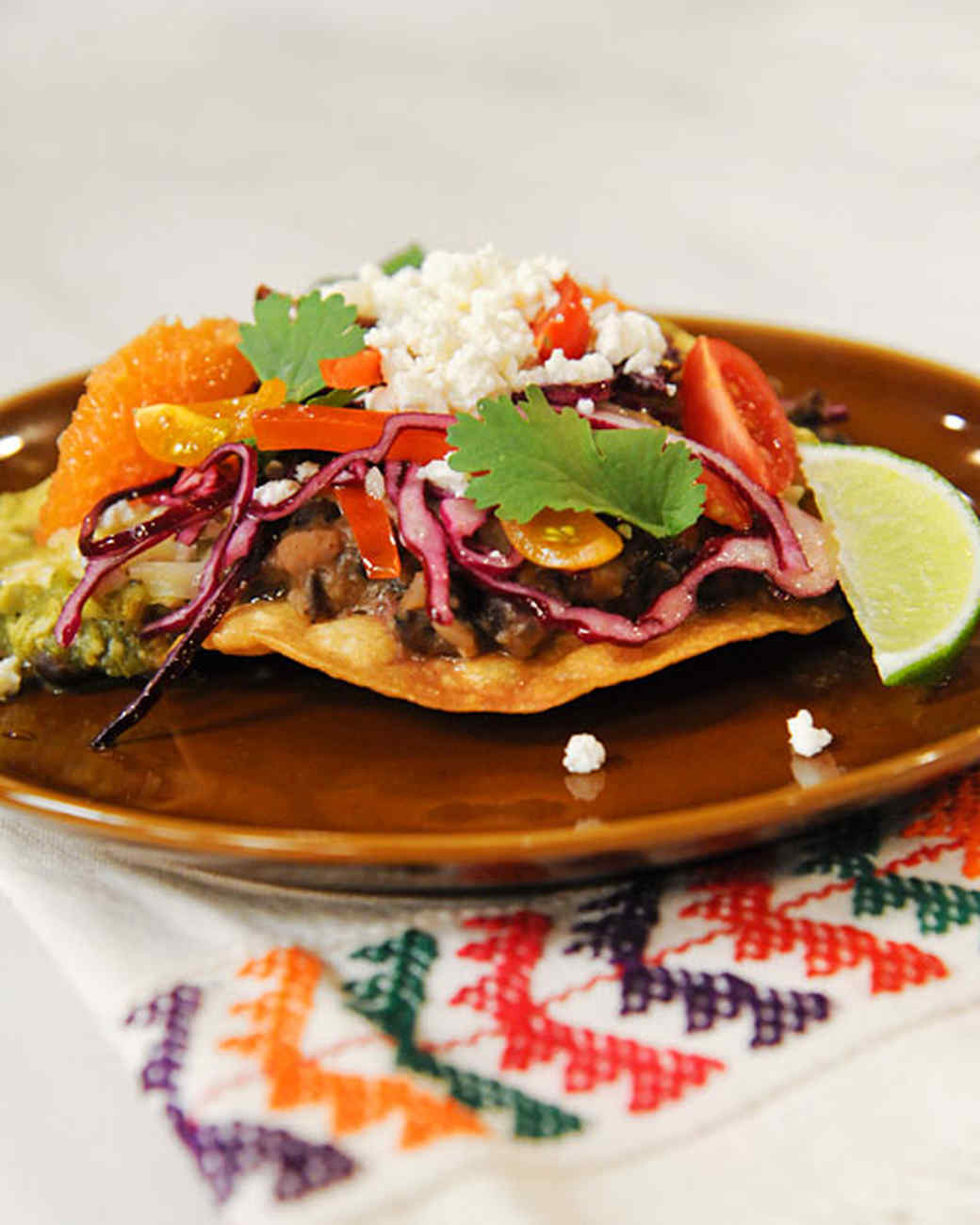Chicken Tomatillo Tostadas with Refried Black Beans and Cabbage-Pepper Slaw
