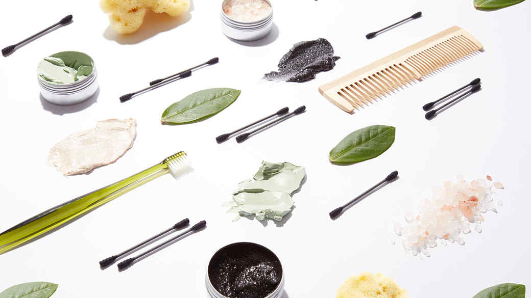 beauty products spread out on white table