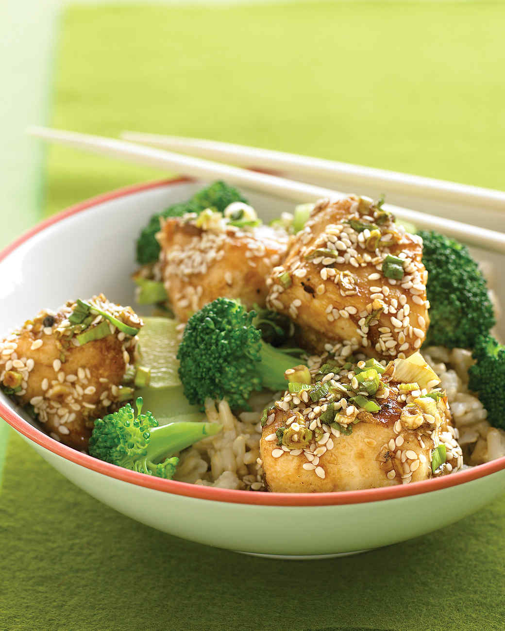 sesame chicken on green plate