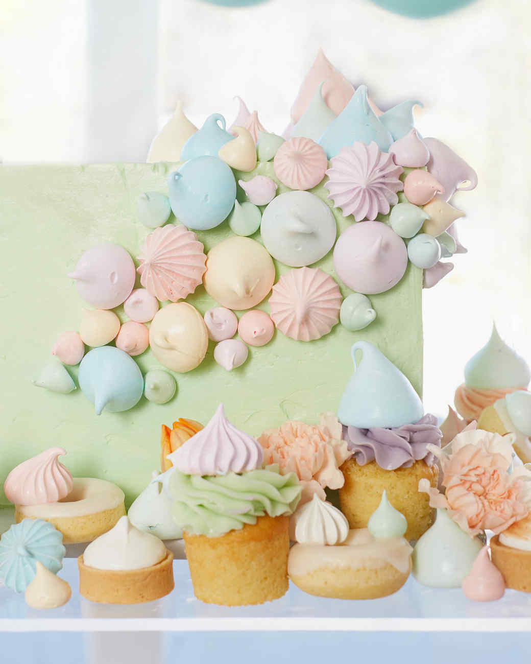 closeup of cupcakes and donut desserts at baby shower