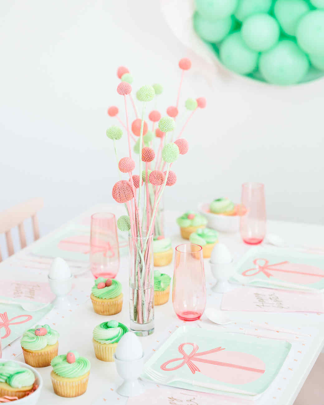 closeup of easter party kids table with green cupcakes