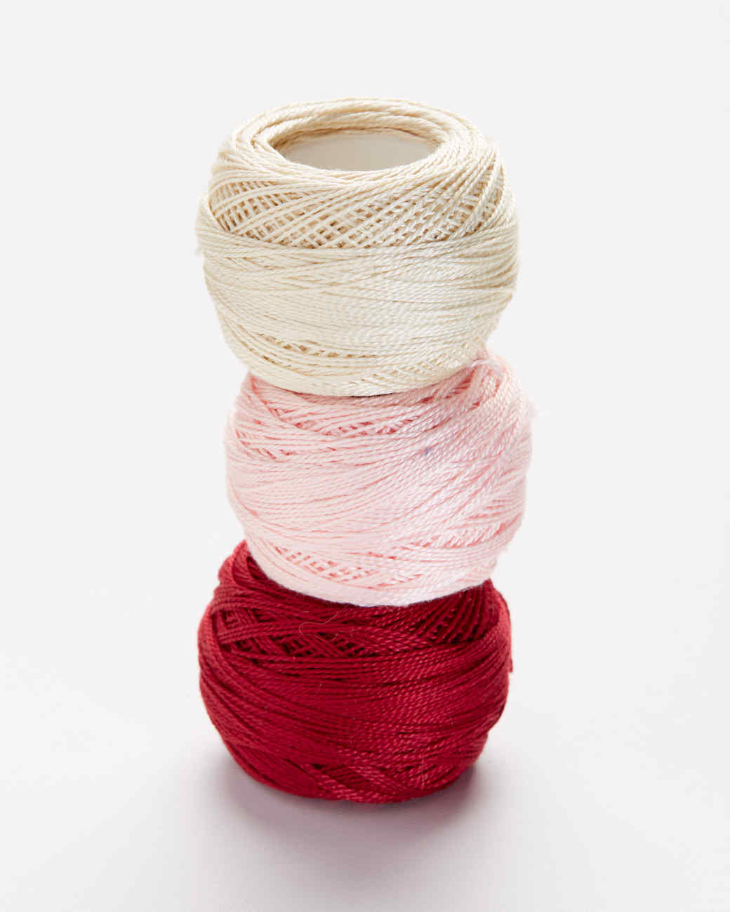 three types of cotton embroidery thread stacked