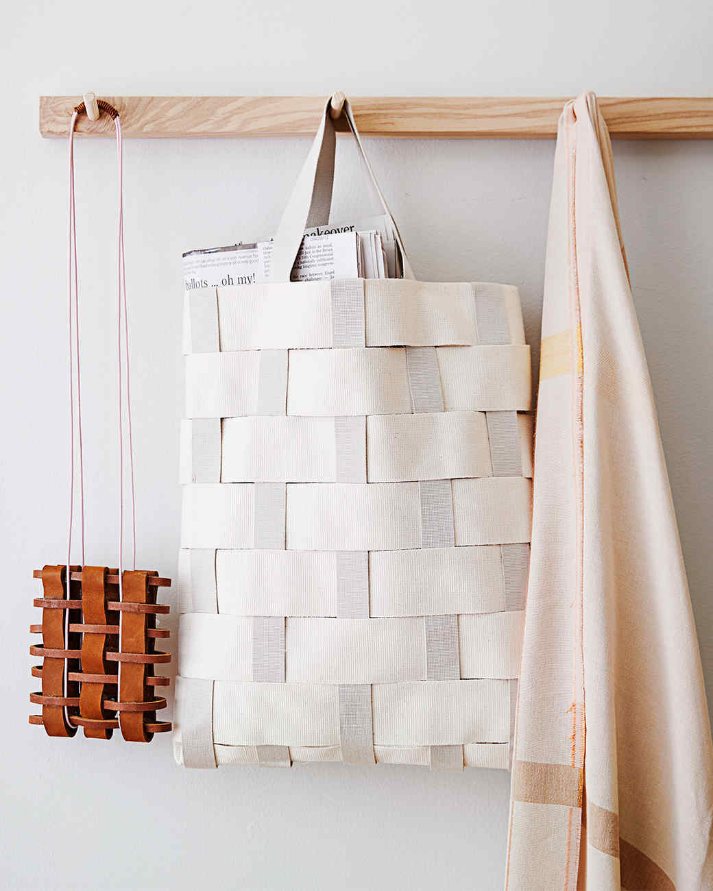 woven tote bags hanging on the wall
