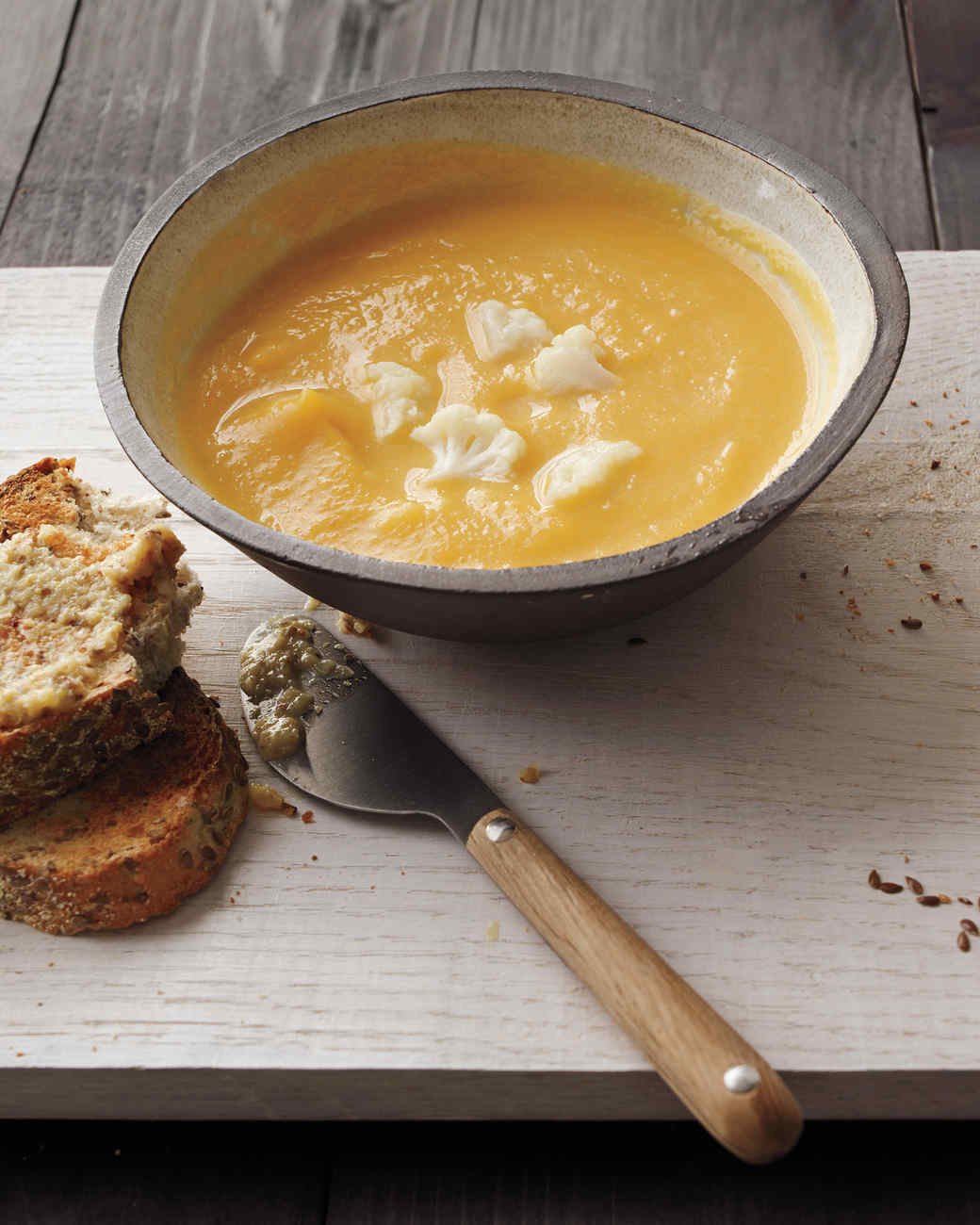 Roasted Butternut-Squash Soup with Cauliflower, Caramelized Onion, and Raisin Vinaigrette