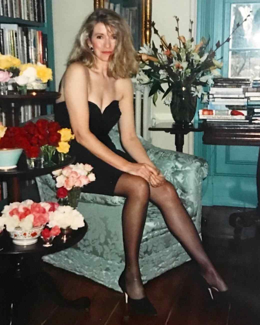 martha in black dress sitting in library