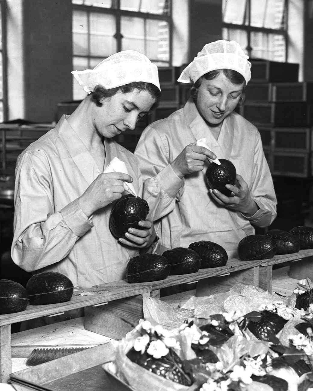two women making cadbury chocolate eggs