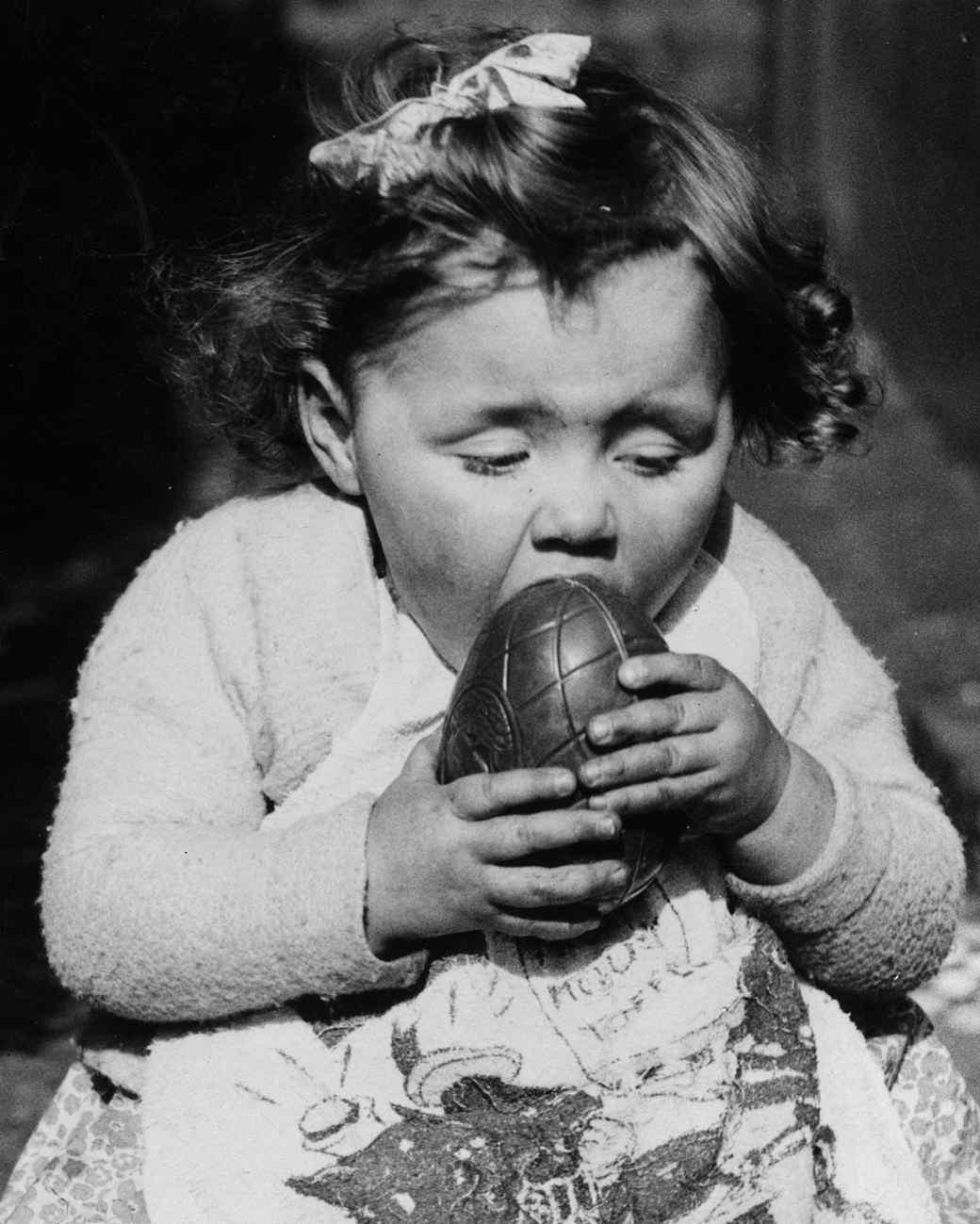 little girl biting into cadbury egg