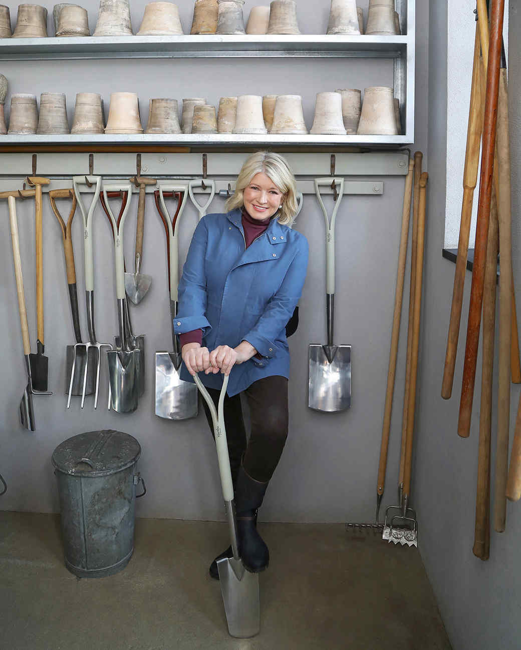 martha holding amazon garden shovel in tool shed