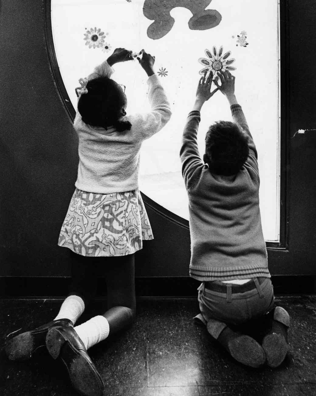 children decorating window for easter