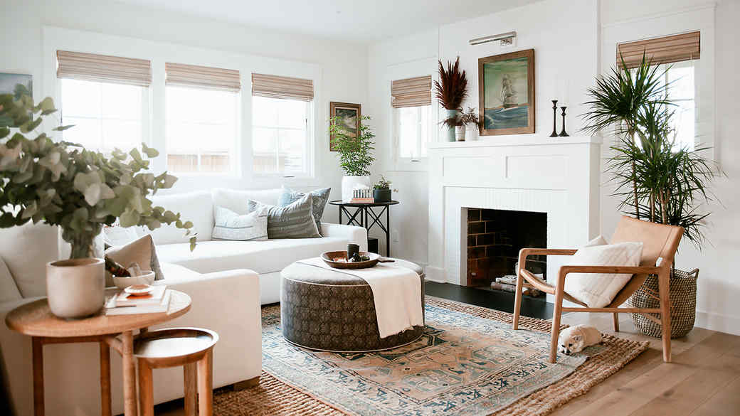 white living room with sectional and wood accents