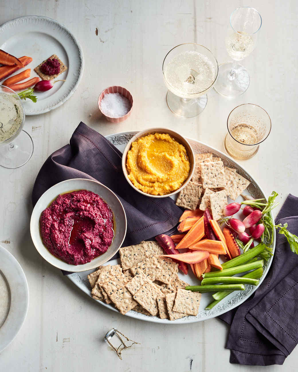 fall potluck relish tray and glasses of champagne on table