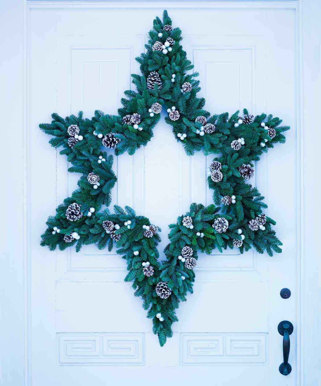 Star Wreath with Glitter-Dusted Pinecones and Baubles | Martha Stewart