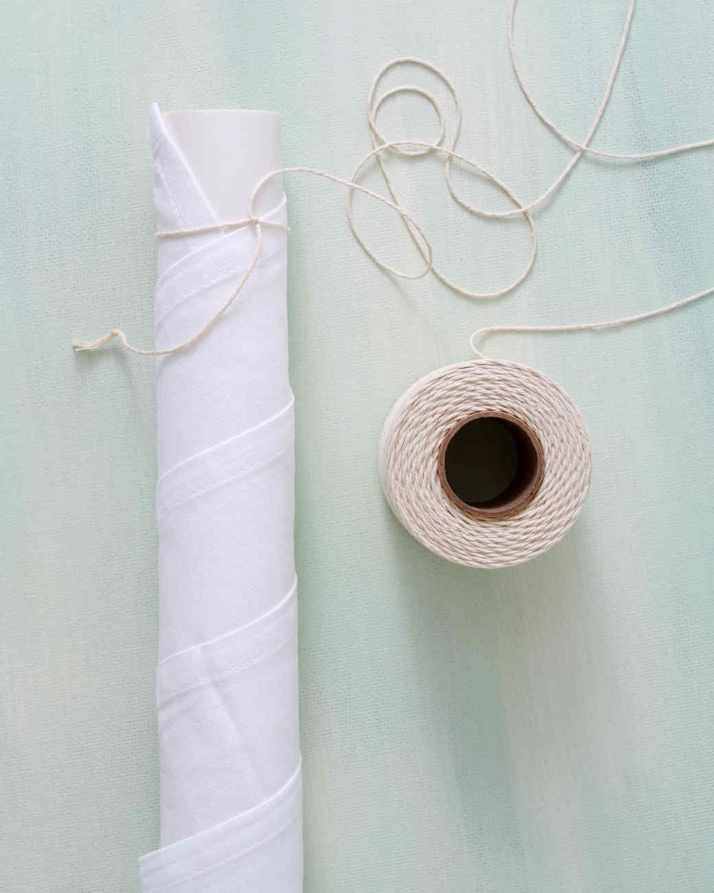 twine tied on fabric wrapped pole