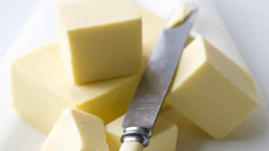 pieces of butter with butter knife