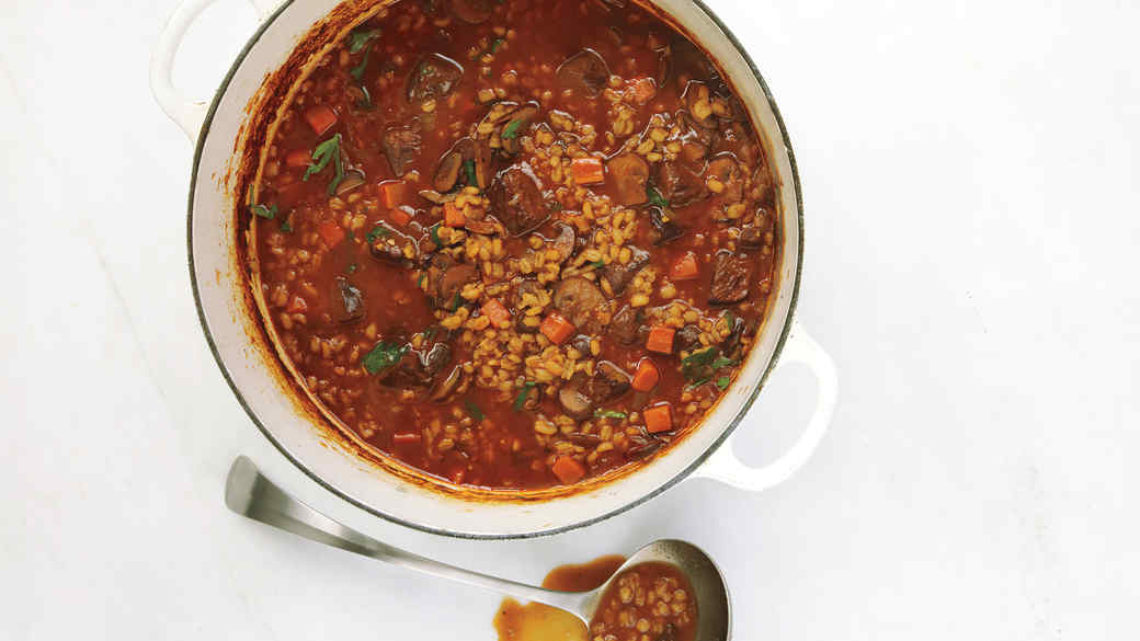 fit to eat beef soup in a white pot with silver ladle