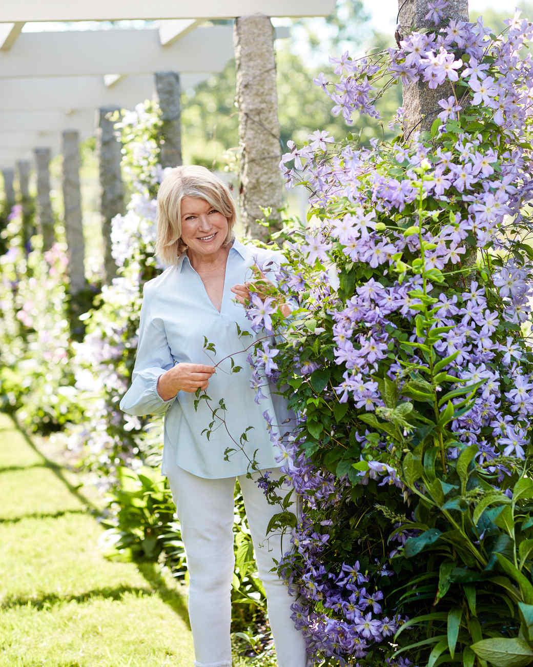martha standing next to purple flowers