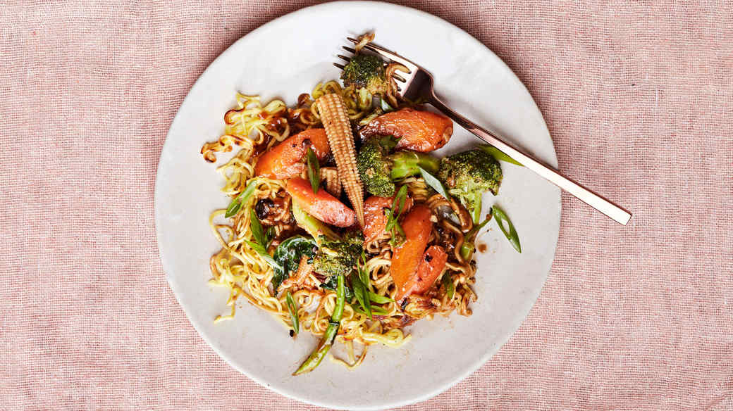 vegetarian chow mein on white plate with fork