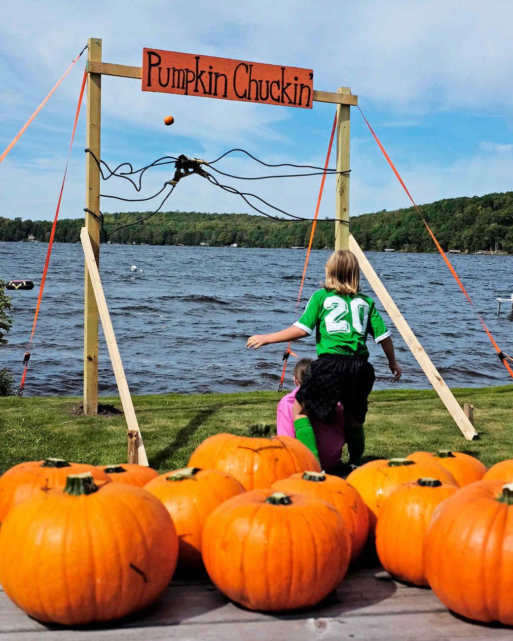 kids chucking pumpkins into lake