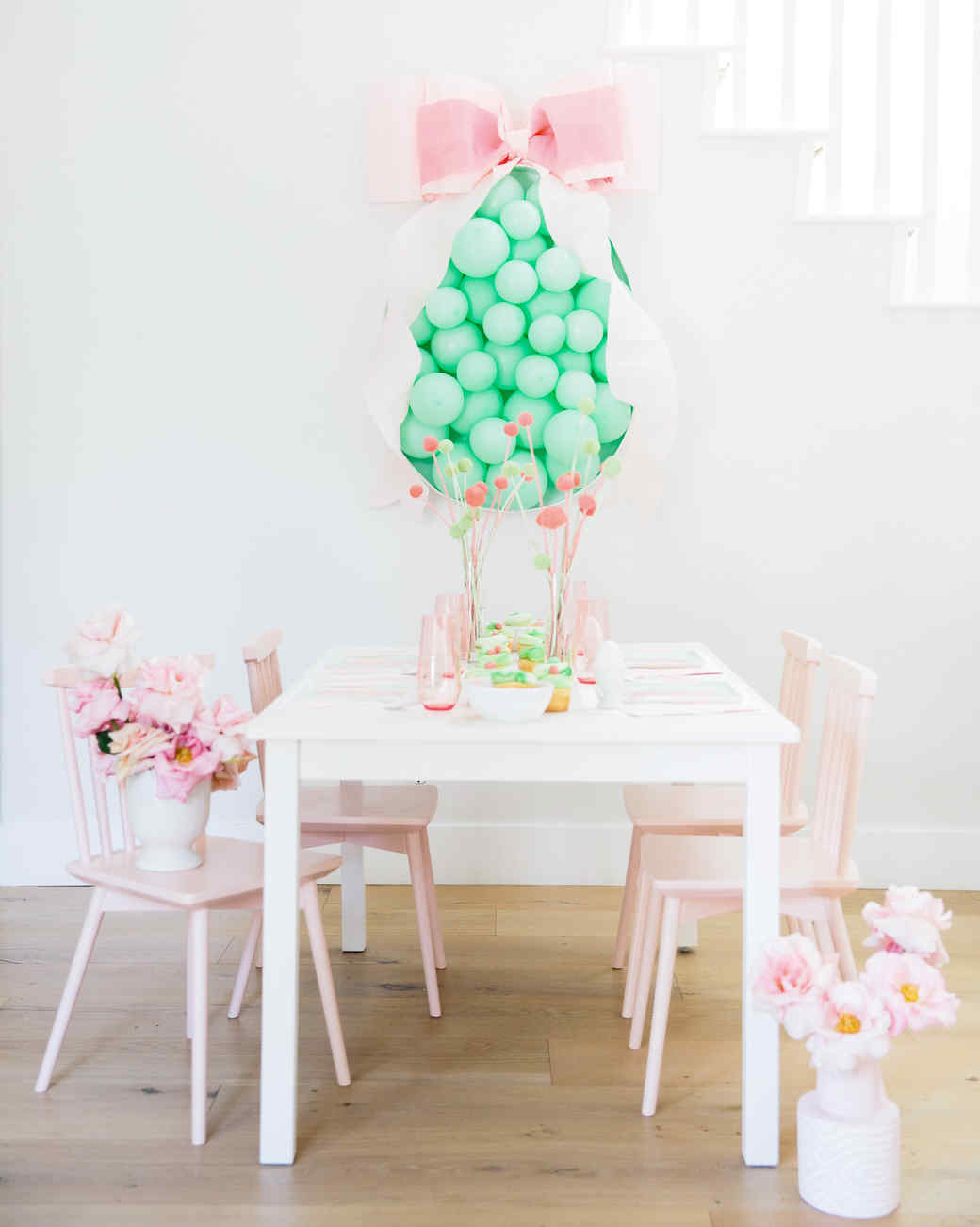 Green Easter Egg Balloon With Pink Decor On Table
