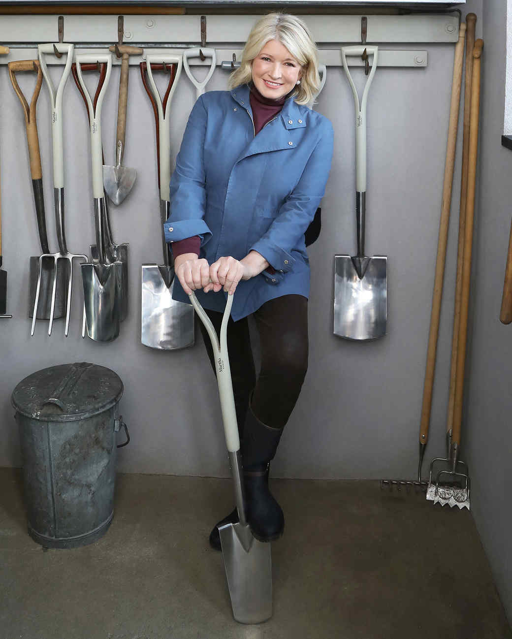 martha stewart standing with a shovel