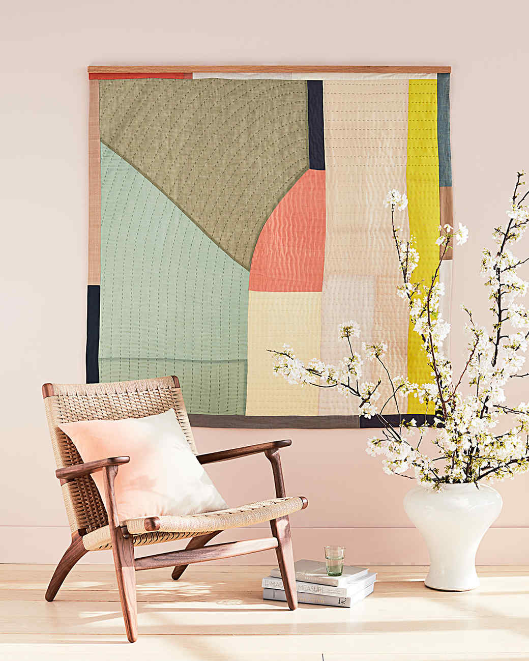 oversized quilt framed on wall