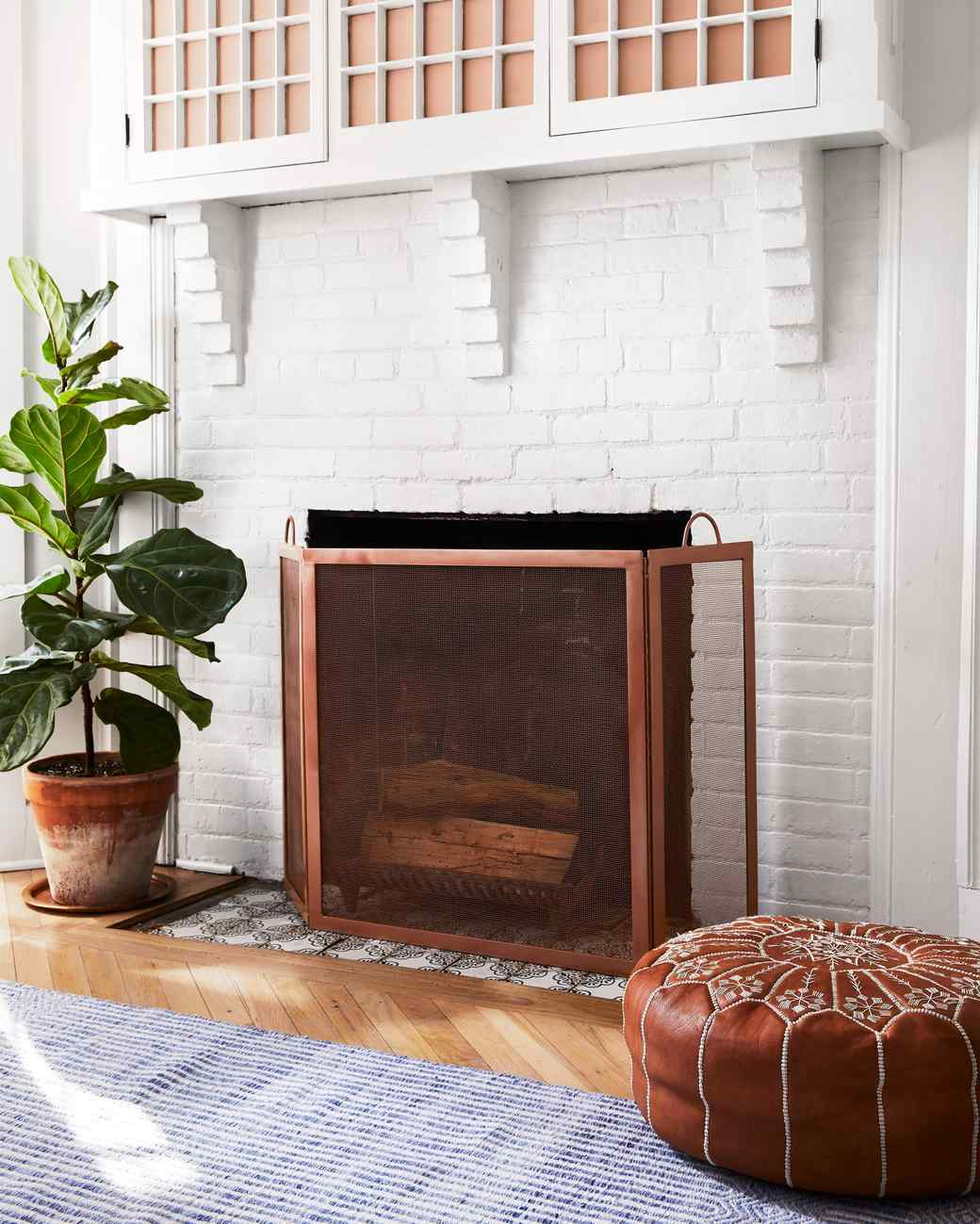 white brick fireplace with painted cover