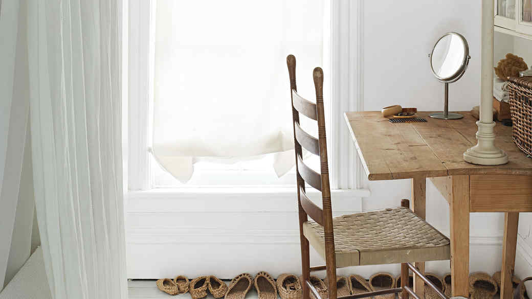 white room with light wood table