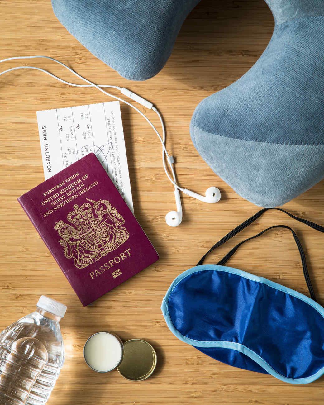 long haul flight essentials password, sleep mask, headphones, and pillow