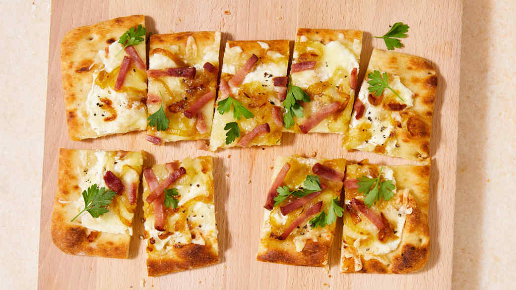 alsatian flatbread topped with flat-leaf parsley