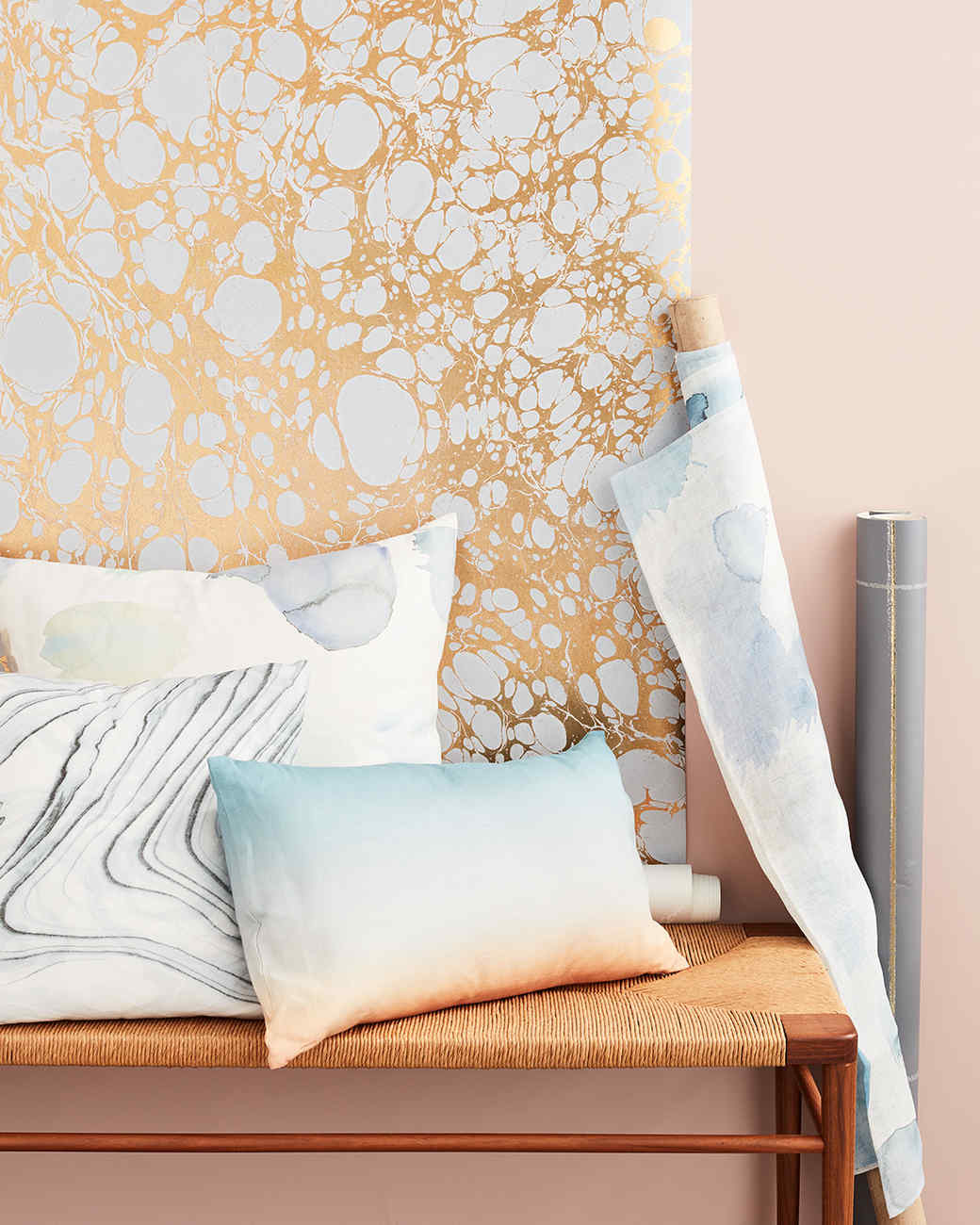 calico wallpaper and pillows on bench