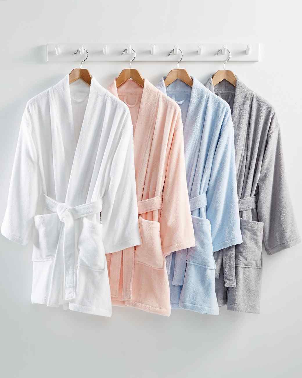four hanging cotton bathrobes