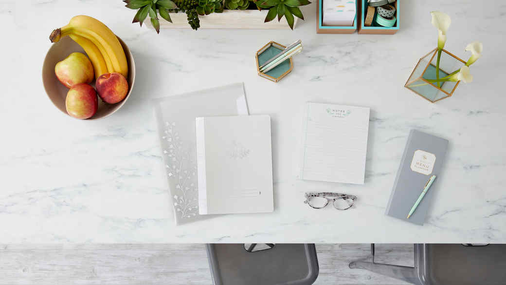 gray office supplies on marble desk