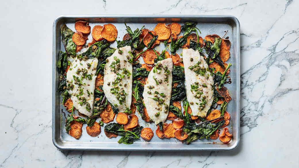 fish and vegetables on baking sheet