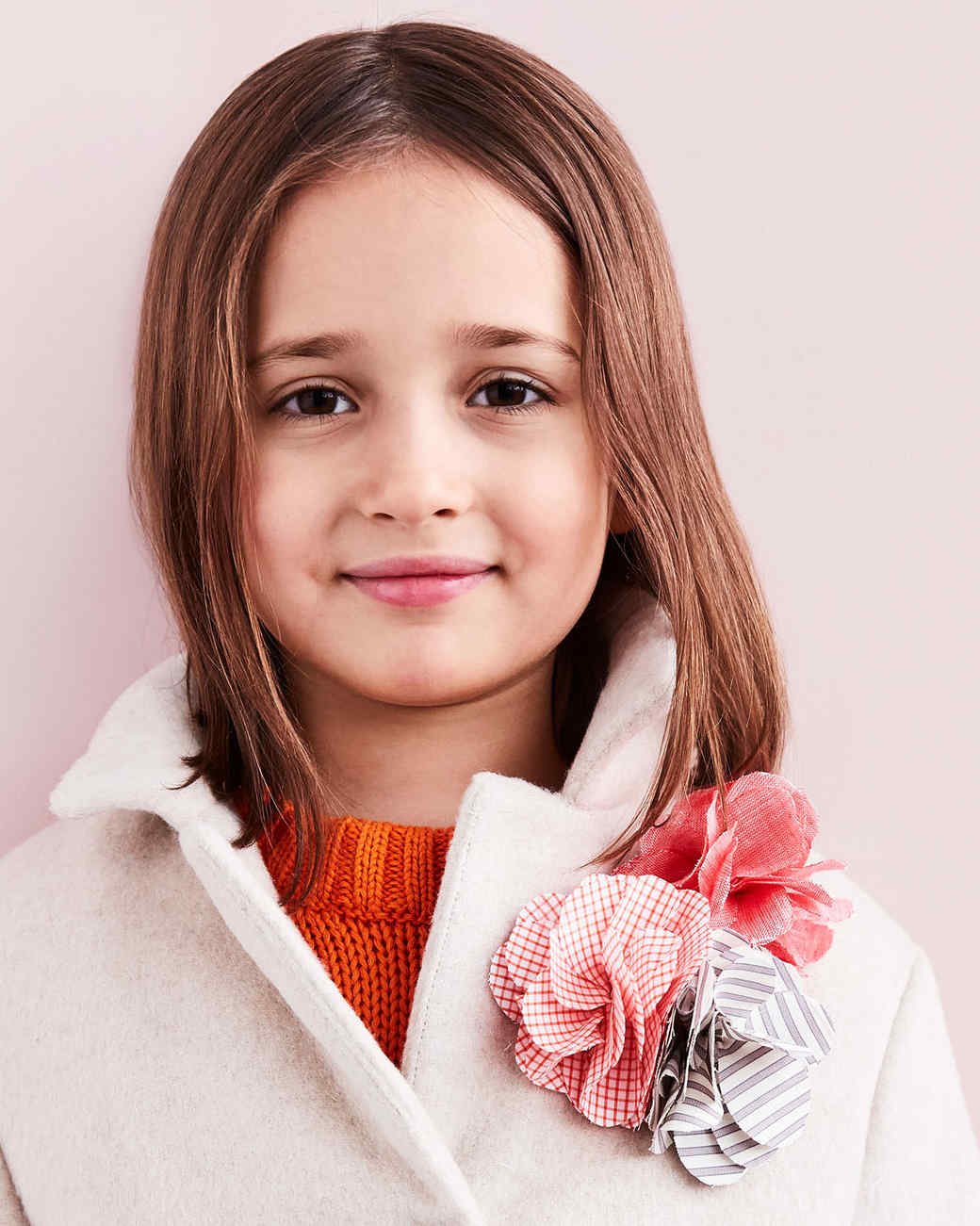 flower pin on little girl's coat