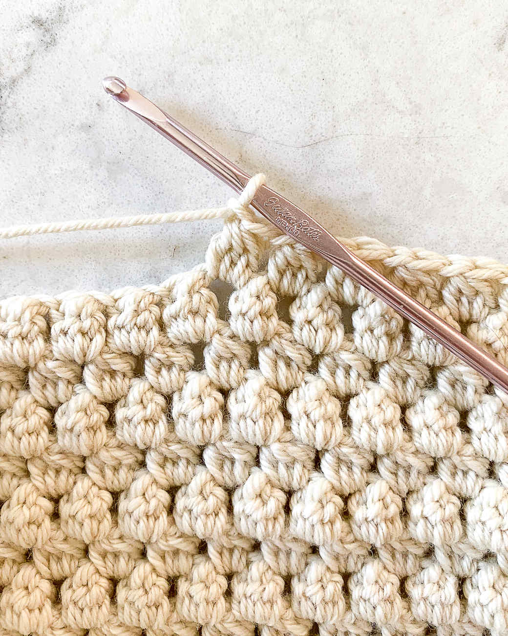making the soft bobble stitch for a crochet baby blanket