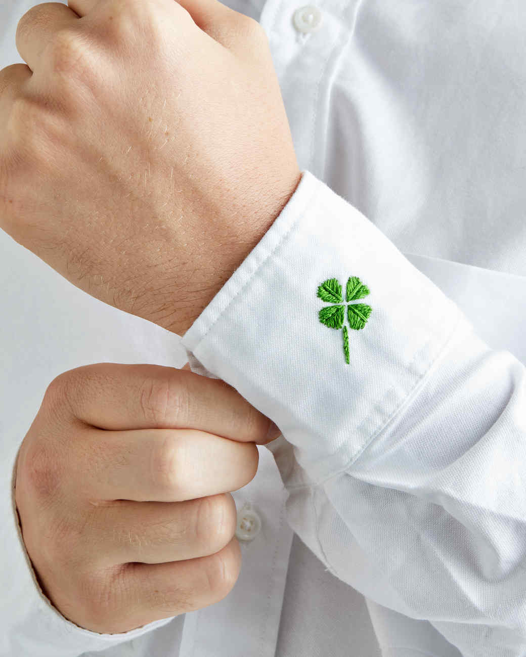 embroidered four-leaf clover on a man's shirt cuff
