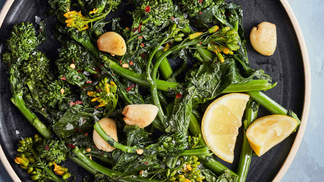 simply sauteed broccoli rabe healthy sidedish on blue table