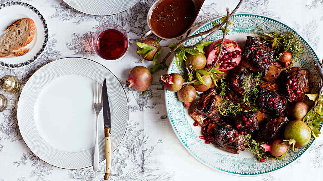 miso-tomato braised short ribs plated with pomegranate