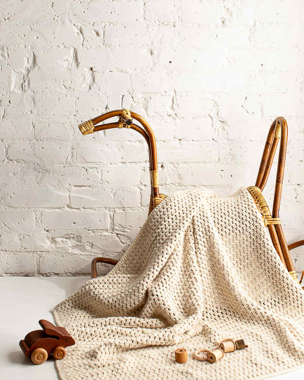 soft bobble crocheted blanket with a stand and toys