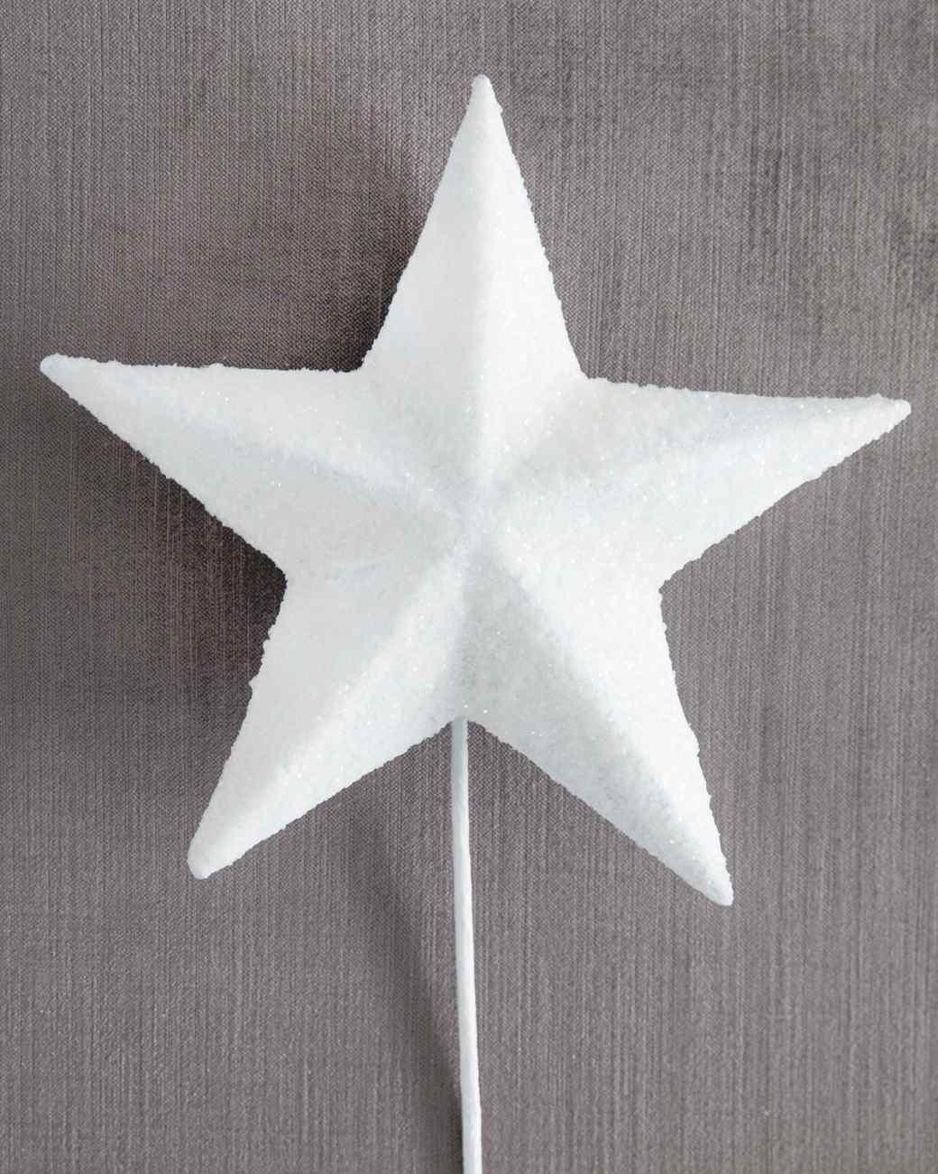 white glittered star tree topper