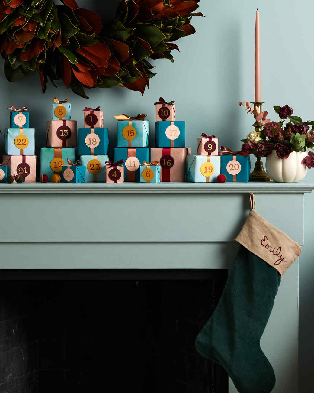 mantle blue wall with advent calendar presents stocking candles wreath