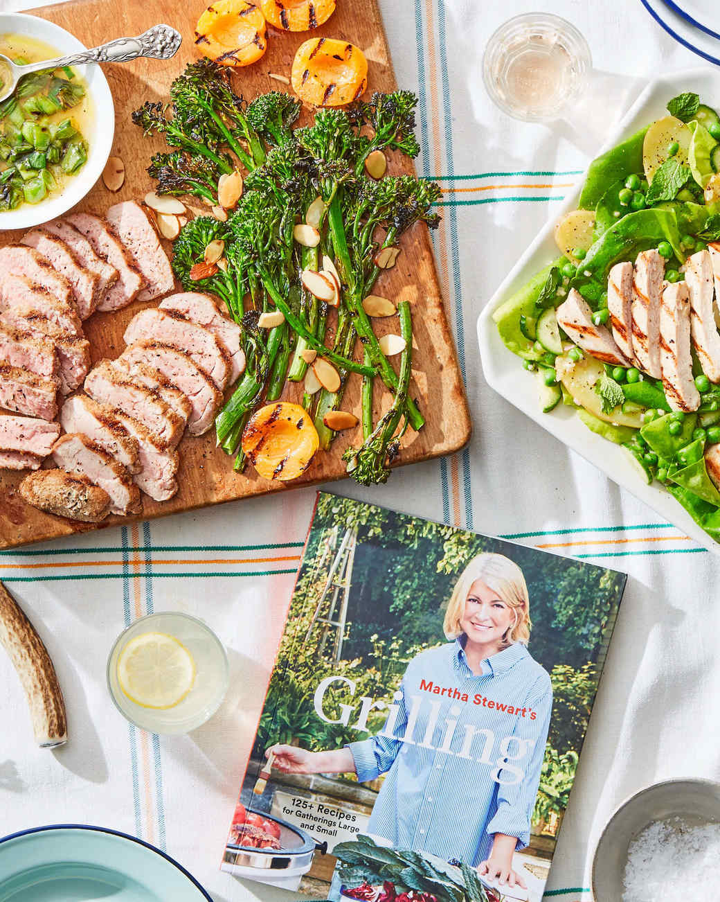 martha grilling book on table with grilled food
