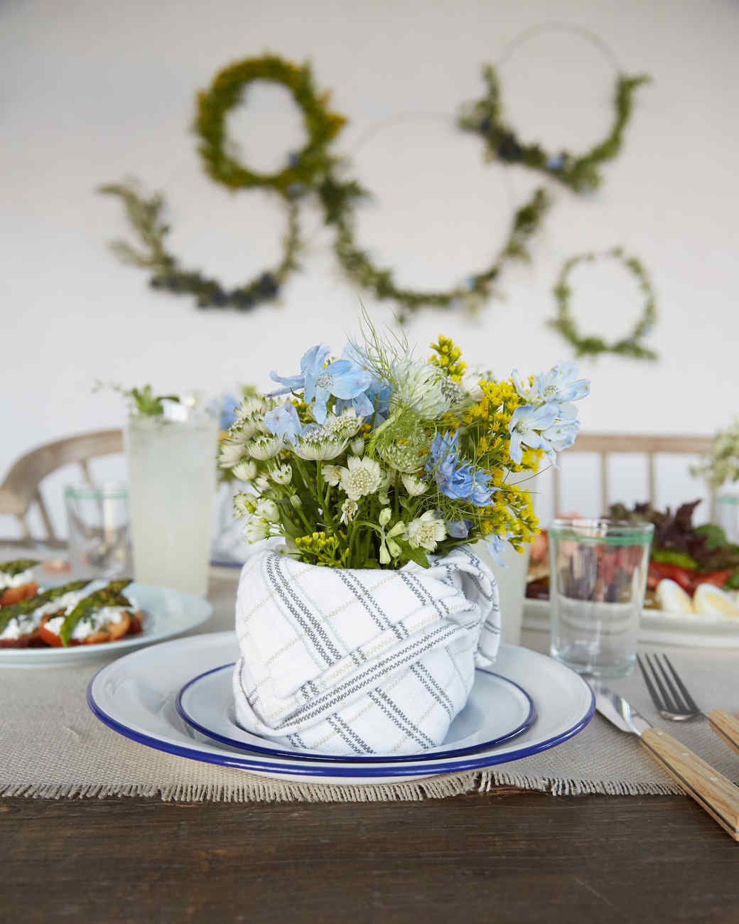 A Napkin Styled As A Vase Holds A Bouquet Of Spring Flowers.