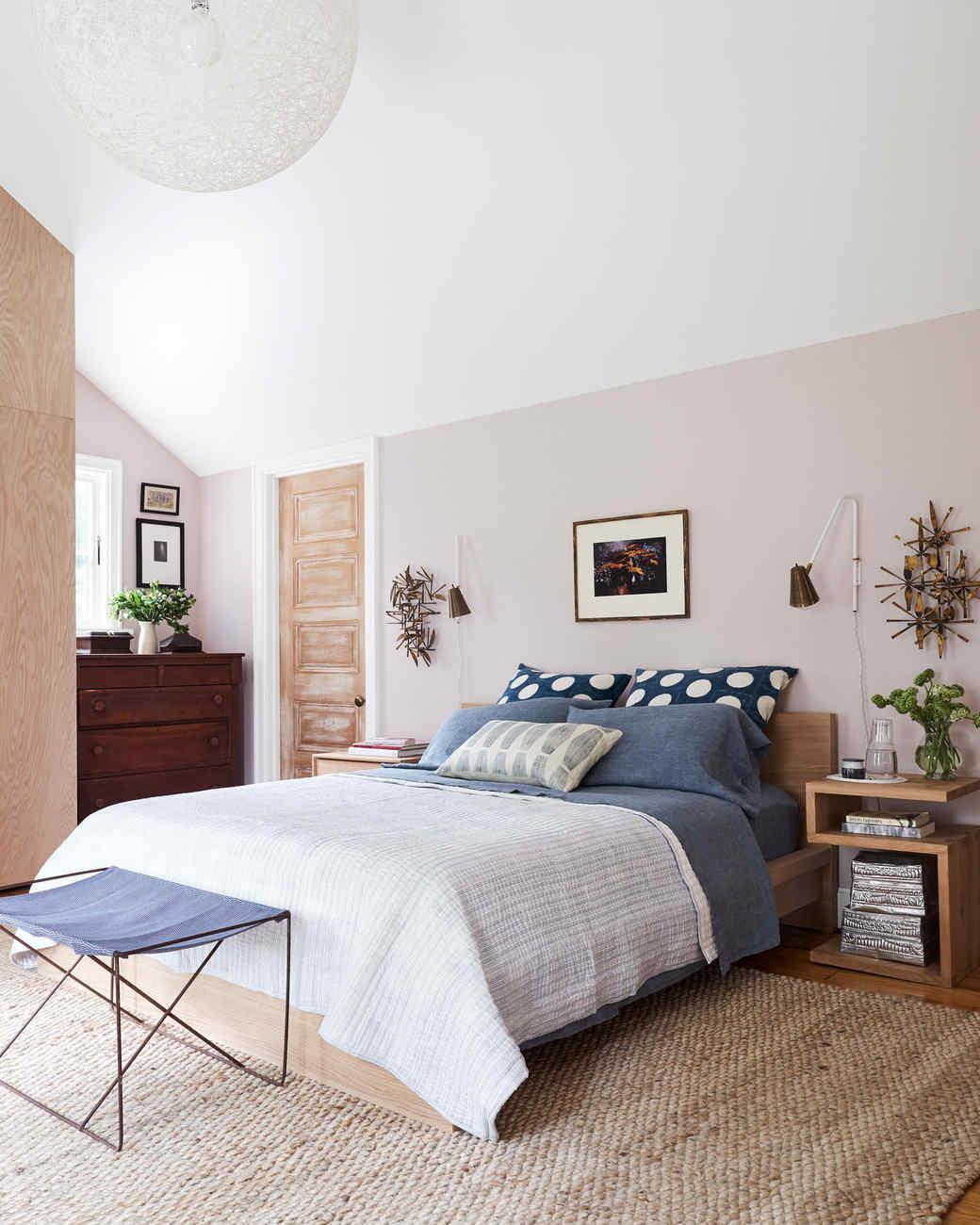 master bedroom with light pink walls blue bedding