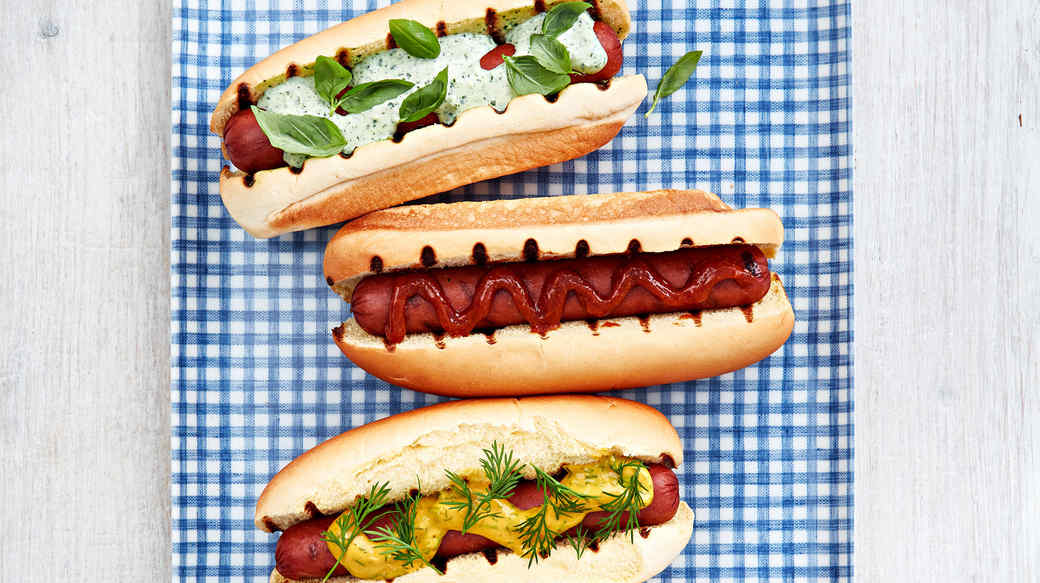 hot dog varieties on blue checkered platter
