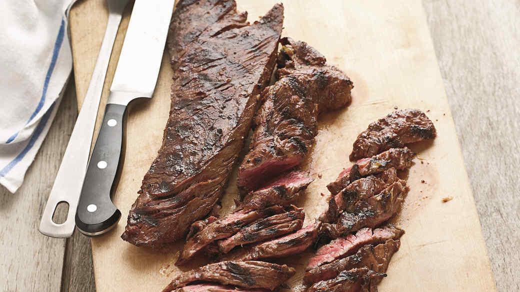 pat lafrieda balsamic marinated hanger steak on a wood cutting board