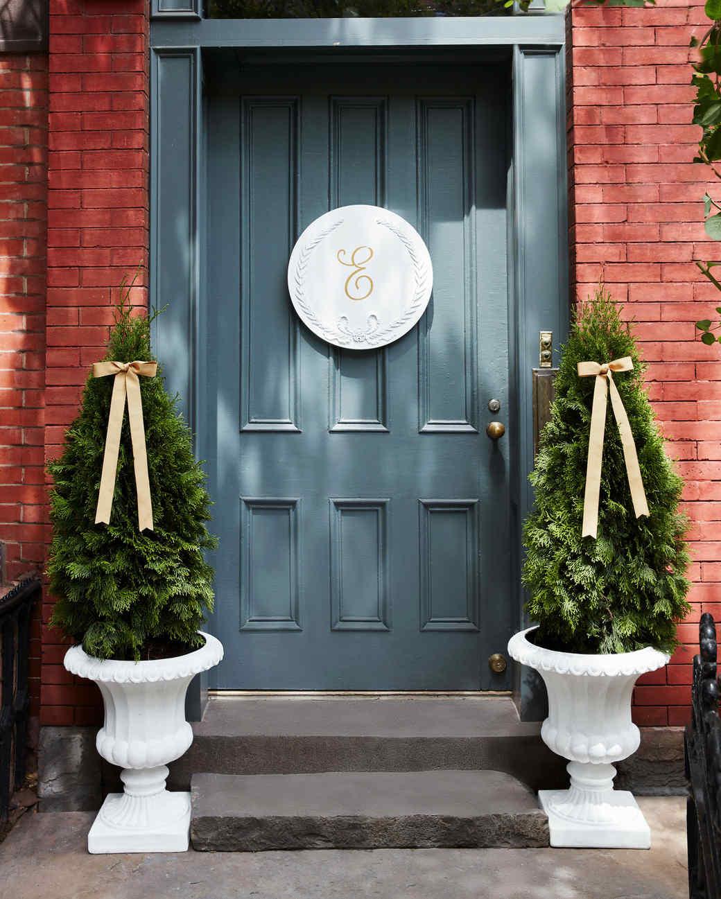 chalk painted white monogram plaque front door stoop