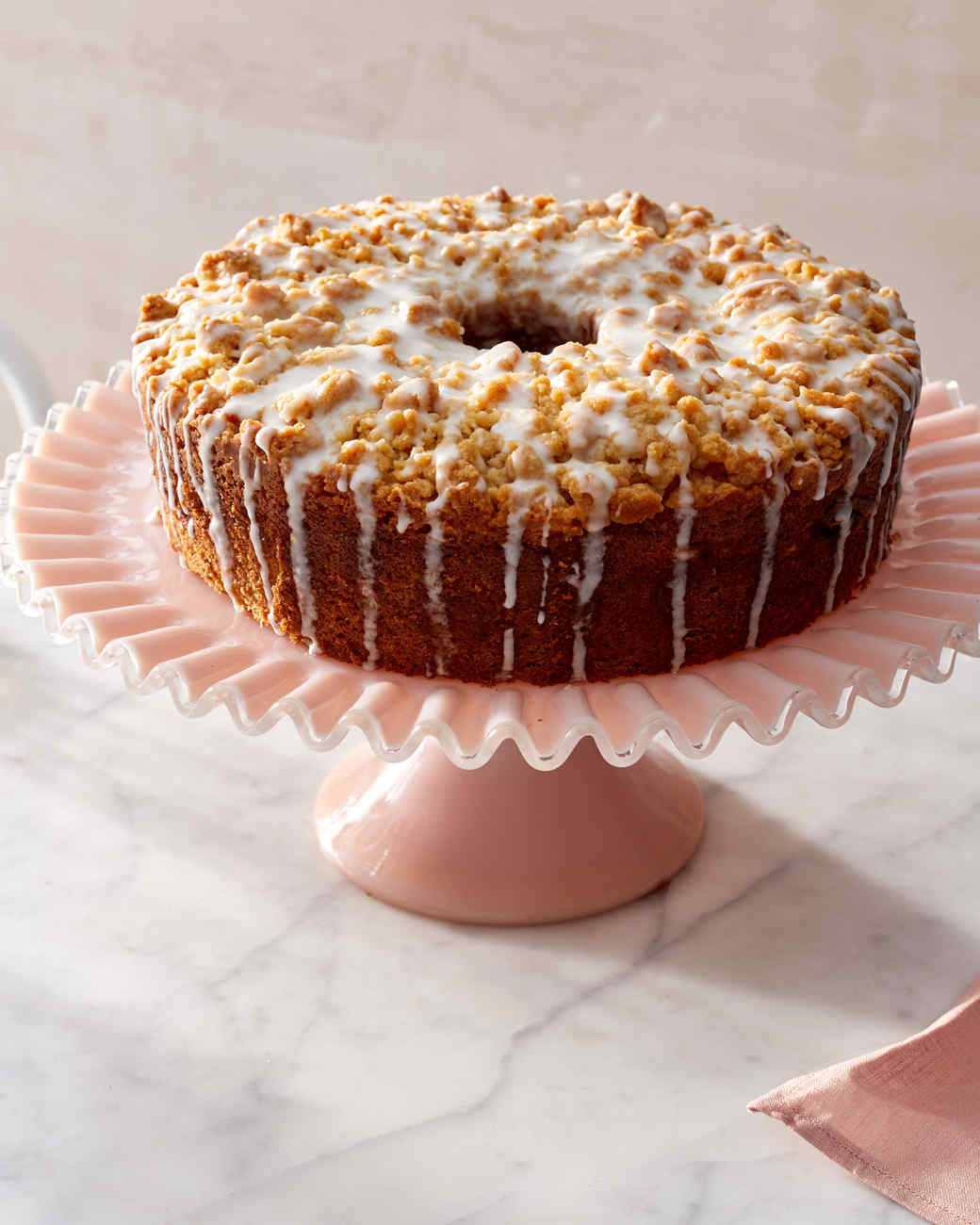 meyer lemon coffee cake on pink stand