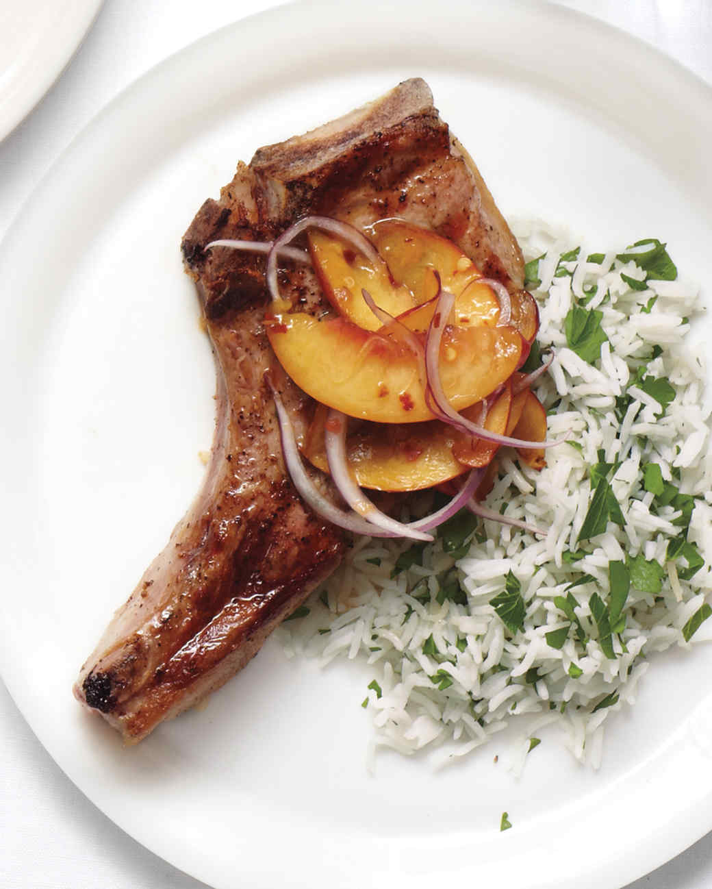grilled-pork-chops-with-peach-relish-and-herb-rice-0615-d107287-0615 ...
