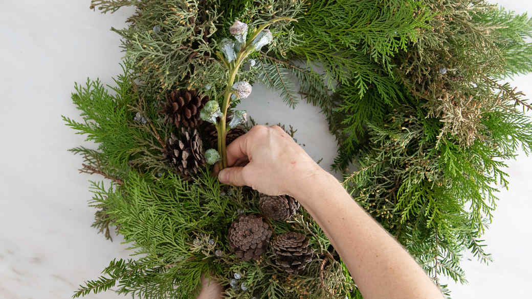 asymmetrical christmas wreath adding decorative elements pinecones pods